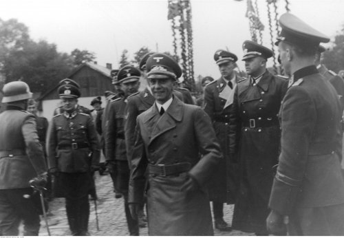 Joseph Goebbels (in the foreground wearing a coat) upon arriving to the General Government for the first anniversary of the outbreak of war, September 1st 1940 (NAC)