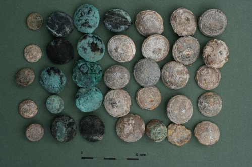 Bykownia - Stalinist Crimes' Victims' Cemetery. Polish uniform buttons found in the grave no. 152/06. Photo: A. Kuczyński