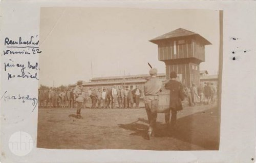 A POW camp, prisoners are waiting in line for dinner; 1920. Author: photographer Jan Zimowski. From the collections of the Museum of the History of Photography in Cracow